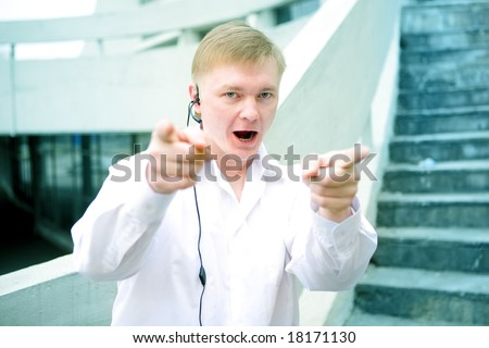 guard officer poke fingers and smile - stock photo