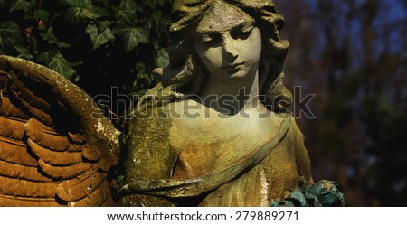 Guardian angel with wings as a symbol of safety and security - stock photo
