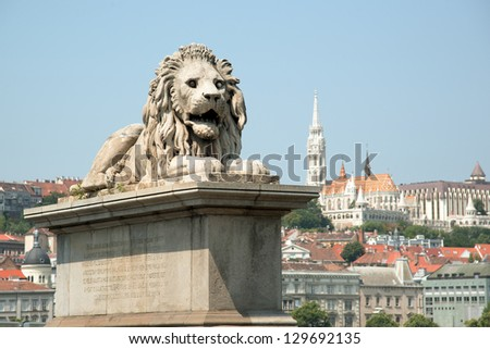 Guardian lion statue with Buda view, Budapest - stock photo
