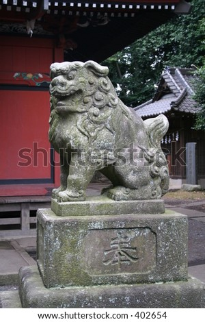 Guardian Statue at a Shinto Shrine in the outskirts of Tokyo, Japan - stock photo
