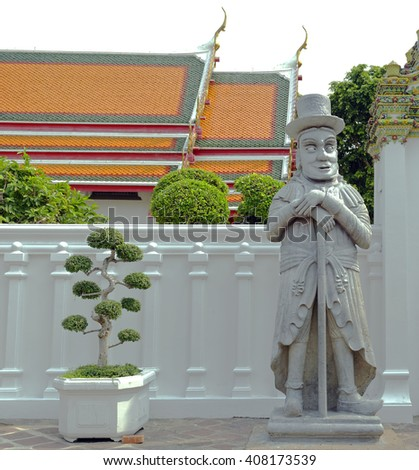 Guardian statue on the grounds of the Wat Pho temple in Bangkok, Thailand - stock photo