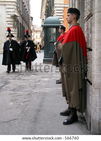 Guards and soldiers of the ancient style at the roman parliament in Italy. - stock photo