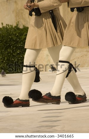 Guards ceremonial  in front of the Tomb of the Unknown Soldier at the Parliament Building in Athens, Greece - stock photo