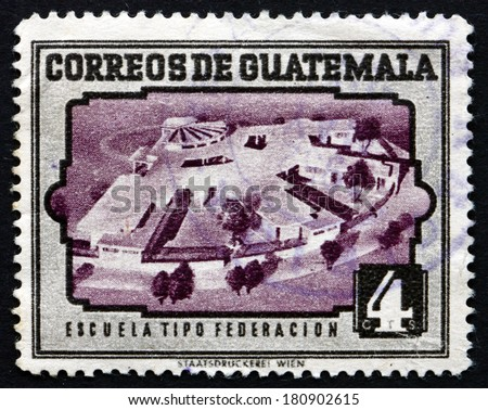 GUATEMALA - CIRCA 1951: a stamp printed in Guatemala shows Modern Model School, circa 1951 - stock photo