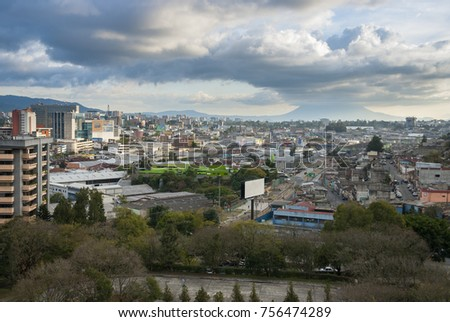 GUATEMALA CITY - January 30, 2012. Panoramic view of Guatemala City, modern and conservative architectural contrast, Central America, in the horizon volcan called Pacaya. EDITORIAL.