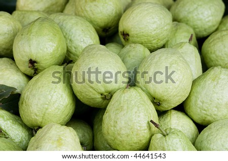 Guavas on a market stall in Asia. - stock photo