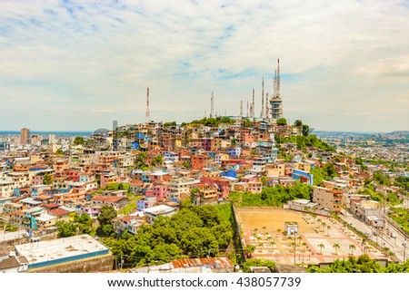 Guayaquil, Ecuador - April 16, 2016: Panoramic view at the cell phone towers and colorful houses of Guayaquil's Cerro Santa Ana neighborhood.