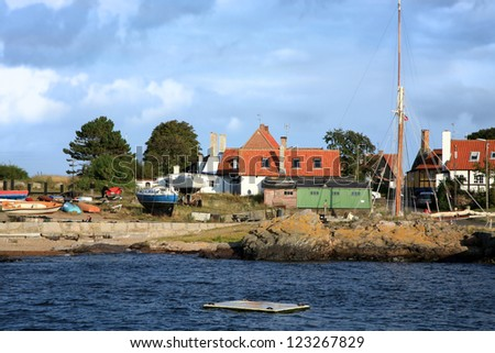 Gudhjem picturesque, small town by sunset on Bornholm Island, Denmark, Europe - stock photo