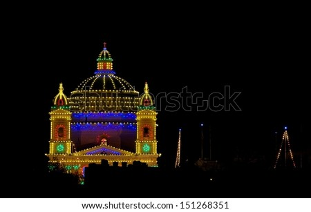 Gudja church on night time with nice colorful illumination, Gudja, Malta, night light, maltese city on the night, catholic church in Malta in dark background - stock photo