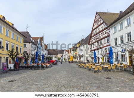 GUENSBURG, GERMANY - APR 29, 2015: people at the old market place in Guensburg, Germany with half timbered and old historic houses. - stock photo