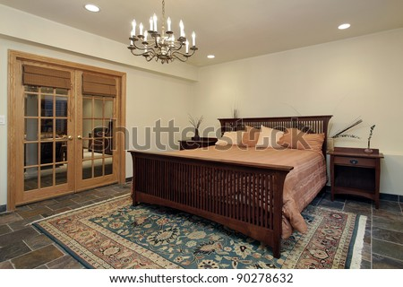 Guest bedroom with oak french doors - stock photo