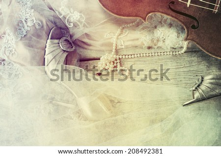Guest book with wedding dress, shoes, pearl - stock photo