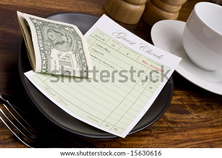 Guest check with cash in cafe
