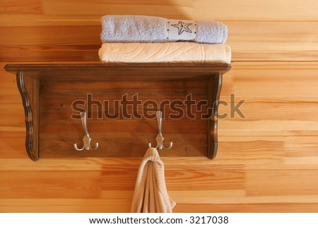 Guest house interior. Shelf and towels. - stock photo
