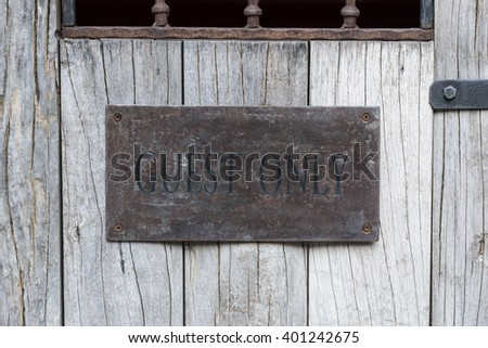 guest only word on the wood door - stock photo