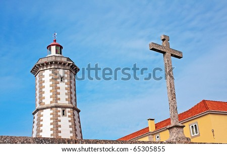 Guia Lighthouse and christian stone cross - stock photo