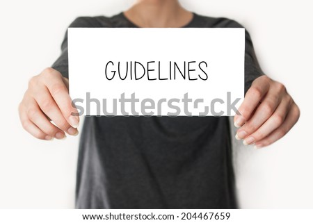 Guidelines. Female in black shirt showing or holding a card - stock photo