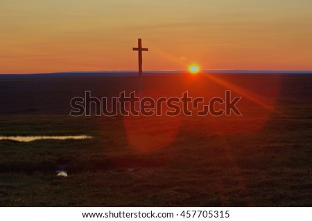 Guiding light. Old cross on Novaya Zemlya archipelago (Barents and Kara seas). Wild places, no man's land, conquest of North . Arctic midnight sun and red sky.