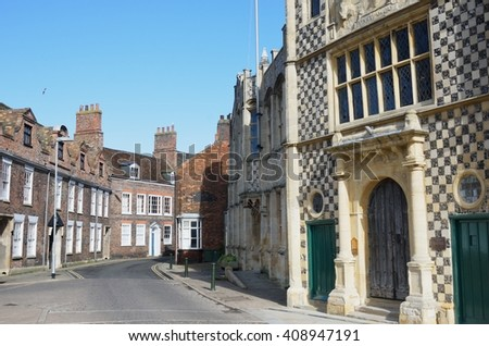 Guildhall Kings Lynn with street view - stock photo