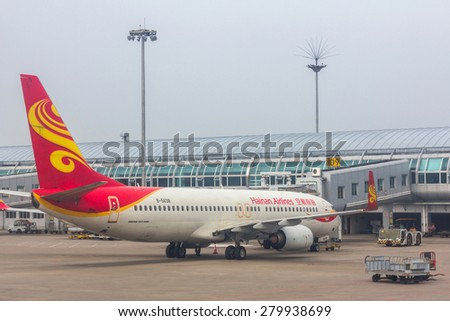 GUILIN, CHINA - APR 30, 2015: Hainan Airlines flight in Guilin Liangjiang International Airport. In 2014, it was the 33rd busiest airport in China with 5875327 people. - stock photo