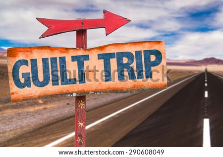 Guilt Trip sign with road background - stock photo