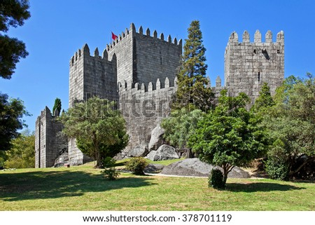 Guimaraes Castle, the most famous castle in Portugal, as it was the birth place of the first Portuguese King and the Portuguese nation. Unesco World Heritage Site. Seen from the public garden. - stock photo