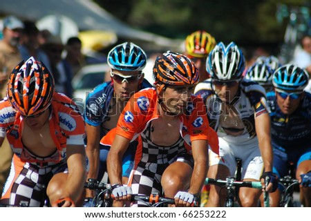 GUIMARAES, PORTUGAL - AUGUST 9: An unidentified group of cyclists ride to win the Volta a Portugal, the world famous Portuguese Tour, on August 9, 2009 in Guimaraes, Portugal - stock photo