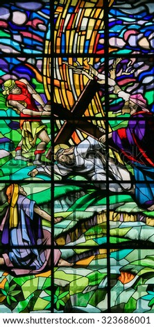 GUIMARAES, PORTUGAL - AUGUST 7, 2014: Stained glass window depicting Jesus on the Via Dolorosa in the Santos Passos church in Guimaraes, Portugal. - stock photo