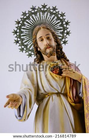 GUIMARAES, PORTUGAL - AUGUST 7, 2014: Statue of Jesus and the Sacred Heart in the Sanctuary of the Rock (Santuario da Penha) in Guimaraes, Portugal.  - stock photo