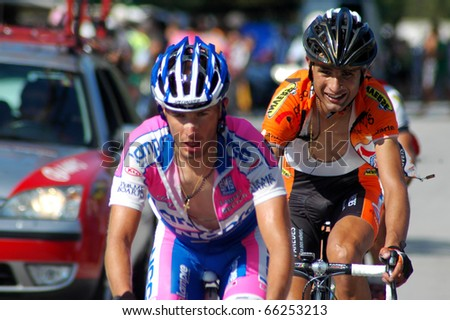 GUIMARAES, PORTUGAL - AUGUST 9: Unidentified cyclist in huge effort to overcome his opponent at the world famous Portuguese Tour on August 9, 2009 in Guimaraes, Portugal - stock photo