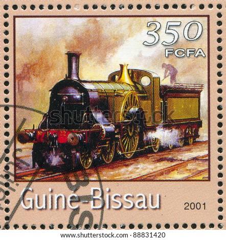 GUINEA-BISSAU - CIRCA 2001: A stamp printed by Guinea - Bissau, shows locomotive, circa 2001. - stock photo