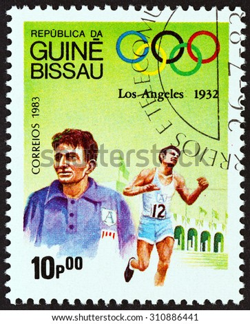 """GUINEA-BISSAU - CIRCA 1983: A stamp printed in Guinea-Bissau from the """"Olympic Games, Los Angeles 1932 and 1984 """" issue shows Marathon, Juan Carlos Zabala, Argentina, circa 1983.  - stock photo"""