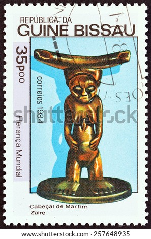 """GUINEA-BISSAU - CIRCA 1984: A stamp printed in Guinea-Bissau from the """"World Heritage """" issue shows carved statuette of woman, Zaire, circa 1984.  - stock photo"""