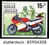 GUINEA-BISSAU - CIRCA 1985: A stamp printed in Guinea-Bissau shows image of a motorcycle, circa 1985 - stock photo