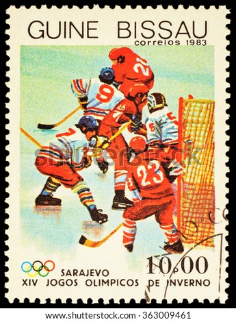 GUINEA-BISSAU - CIRCA 1983: stamp printed in Guinea-Bissau shows hockey match, devoted to the 14th Winter Olympics in Sarajevo, series, circa 1983 - stock photo