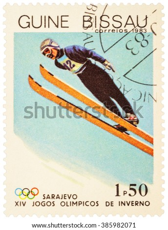 GUINEA-BISSAU - CIRCA 1983: stamp printed in Guinea-Bissau shows ski jumping, devoted to the 14th Winter Olympics in Sarajevo, series, circa 1983 - stock photo