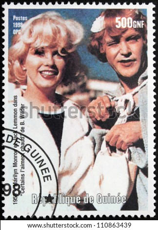 "GUINEA - CIRCA 1998: A postage stamp printed by Guinea shows famous American actress Marilyn Monroe and actor Jack Lemmon starring in the film ""Some Like It Hot"", circa 1998 - stock photo"