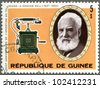 GUINEA - CIRCA 1976: A stamp printed by Guinea shows Alexander Graham Bell (1847-1922), telephone, circa 1976 - stock photo