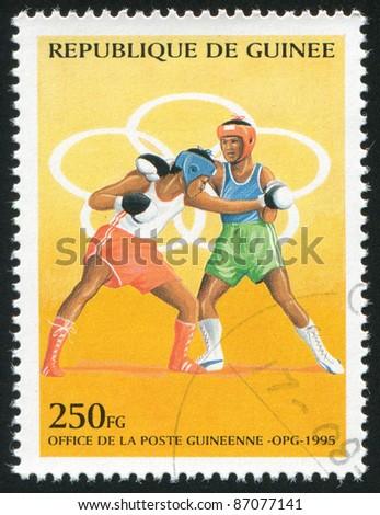 GUINEA - CIRCA 1995:   stamp printed by Guinea,  shows boxing, circa 1995. - stock photo