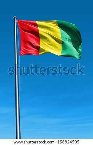 Guinea flag waving on the wind - stock photo