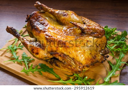 Guinea fowl bird cooked in the oven - stock photo