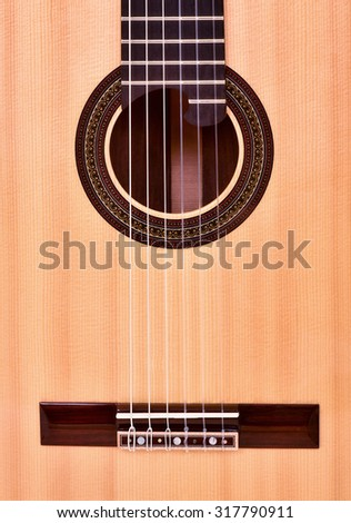 guitar acoustic  nylon center body - stock photo