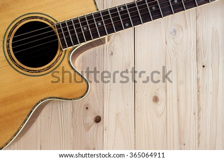 guitar acoustic on top wood table