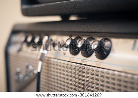 Guitar amplifier knobs detail in studio with selective focus on knobs - stock photo