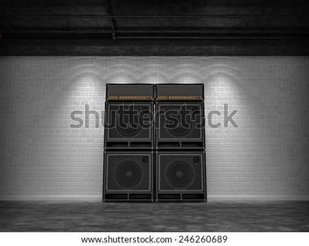 Guitar amps against a white brick wall