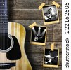 Guitar and guitarist photo photo frame on wood background. - stock photo