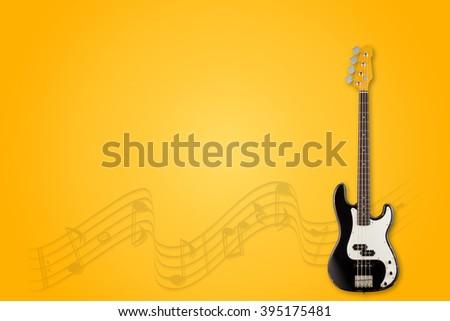 Guitar and notes on orange background - stock photo
