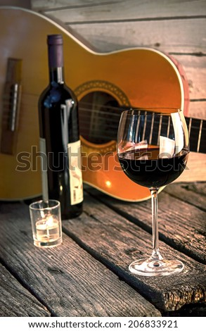 guitar and Wine on a wooden table romantic dinner background - stock photo