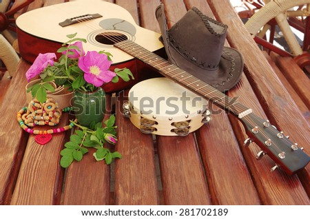 Guitar,flowers, hat and music instruments - stock photo