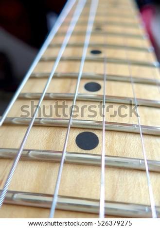 Closeup On Guitar Fretboard Stock Photo 713028232